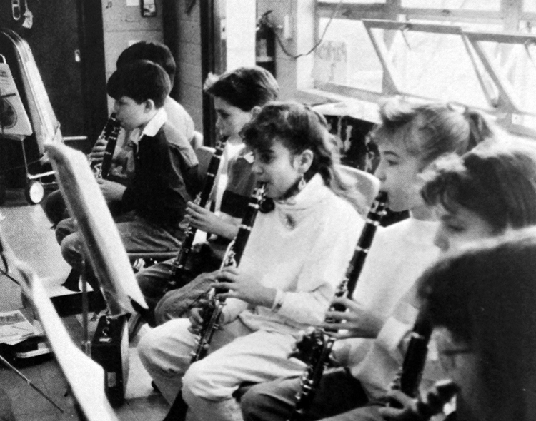 Black and white yearbook photograph of a group of Cherry Run students playing clarinets.